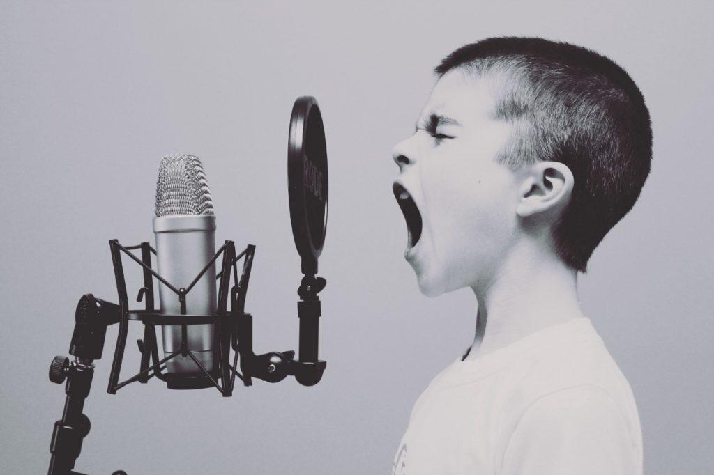 Child screams into a microphone