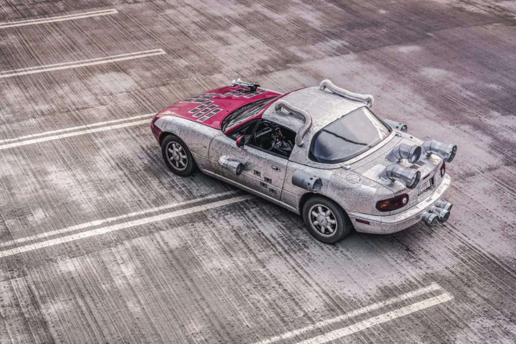 Image shows a car with rockets strapped to it